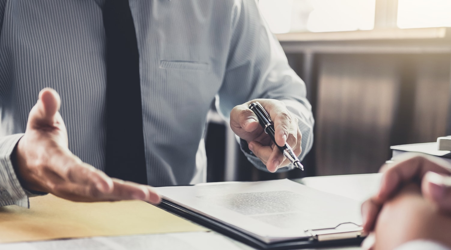 attorney explaining alternative dispute resolution to client